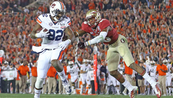 Auburn Tigers wide receiver Melvin Ray (82) avoids Florida State Seminoles defensive back Jalen Ramsey (13) to score on a touchdown pass from Auburn quarterback Nick Marshall (14) in the first half of the BCS Championship at the Rose Bowl in Pasadena, Calif., on Monday. Florida State scored with 13 seconds left to win 34-31. (MCT Direct Photos)