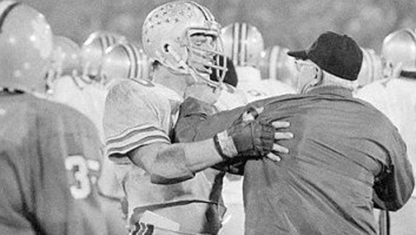 Ohio State guard and former Ironton lineman Ken Fritz (right) holds back head coach Woody Hayes after he hit Clemson linebacker Charlie Bauman in the 1978 Gator Bowl. (Associated Press File Photo)