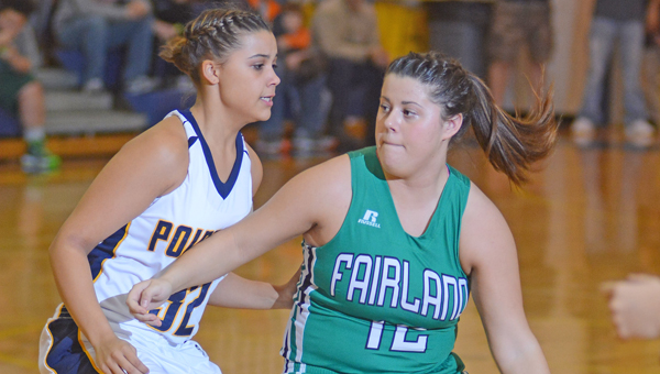 Fairland Lady Dragons' guard Chandler Fulks (12) drives against South Point Lady Pointers' Aundrea Bradburn. Fairland won the key OVC game, 64-44. (Kent Sanborn of Southern Ohio Sports Photos)