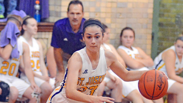 St. Joseph Female Flyers' junior guard Hannah Miller scored her 1,000th career point Saturday in a game at Charleston (W.Va.) Catholic. (Kent Sanborn of Southern Ohio Sports Photos)