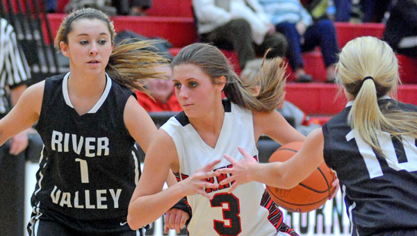 Coal Grove Lady Hornets' Jacy Jones (3) drives through the River Valley defense for a layup,. Coal Grove beat the Lady Raiders  47-45 in overtime on Thursday. (Kent Sanborn of Southern Ohio Sports Photos)