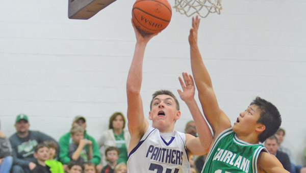 Chesapeake's Brad Meadows (24) drives to the basket as Fairland's Nathan Campbell (15) attempts to block the shot. The Panthers beat Fairland 67-60 on Saturday in a key Ohio Valley Conference game. (Kent Sanborn of Southern Ohio Sports Photos)