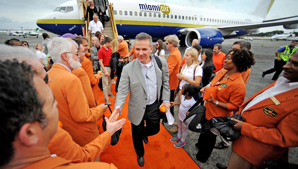 Ohio State football coach Urban Meyer arrives onto the orange carpet as his team arrives at Fort Lauderdale/Hollywood International Airport in Fort Lauderdale, Fla., Sunday. Ohio State will play Clemson in the Orange Bowl Friday night. (MCT Direct Photos)