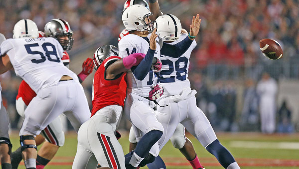 Ohio State Buckeyes' defensive lineman Noah Spence (8) forces a fumble by Penn State Nittany Lions quarterback Christian Hackenberg (14) during a game earlier this season. Spence was suspended by the Big Ten for testing positive for ecstasy. (MCT Direct Photo)