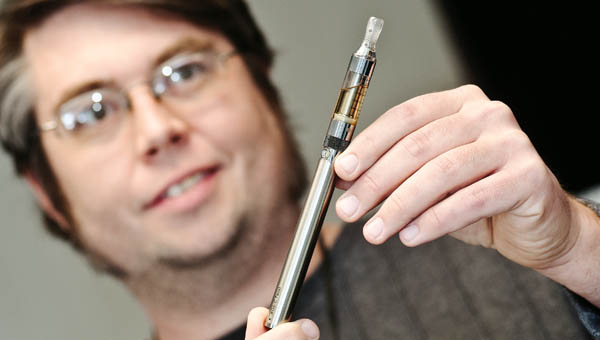 Joe Gehrling shows off his own vaporizer, an electronic cigarette, at his business Vapor Express in Coal Grove.