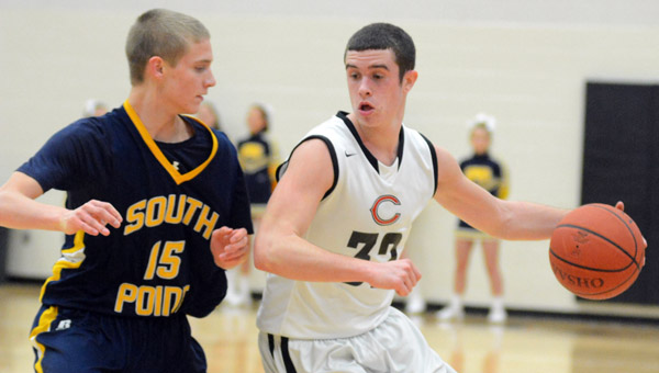 Coal Grove's Conor Markins (32) tries to drive past South Point's Stephen Wagoner (15) during Tuesday's Ohio Valley Conference game. South Point won 51-49. (Kent Sanborn of Southern Ohio Sports Photos.com)