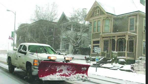 A truck with a snowplow attached makes its way through Ironton on Tuesday.