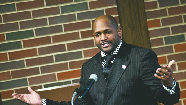 The Rev. James Stowe, with the Quinn Chapel AME Church, speaks to the audience.