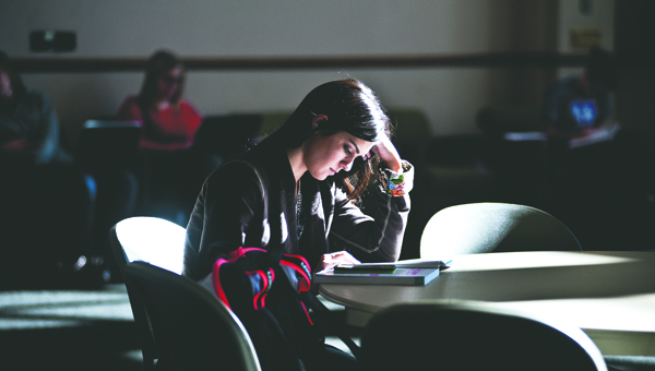 THE TRIBUNE/JESSICA ST JAMES Katie George reads her communications book in the Mains Rotunda at Ohio University Southern. Students have returned to school for the spring.