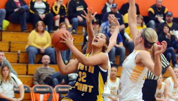 South Point Lady Pointers' Aundrea Bradburn (32) drives through two Lynchburg Clay defenders as she scores two of her 12 points in a 46-40 comeback win Thursday in the Division III district semifinals. (Kent Sanborn of Southern Ohio Sports Photos)