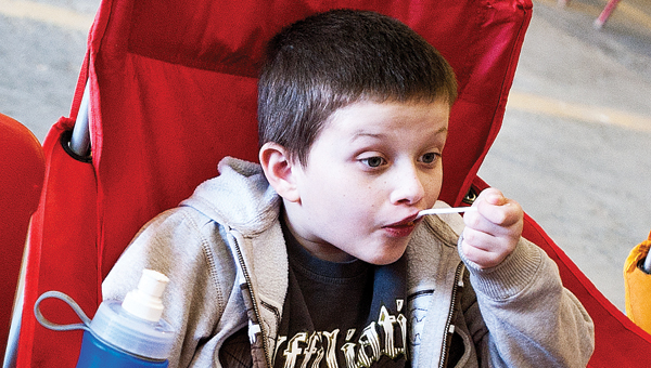 7-year-old Jonny Tibbs takes a bite of chili during the Upper Township Volunteer Fire Department Chili Cook-off Saturday at the fire station;
