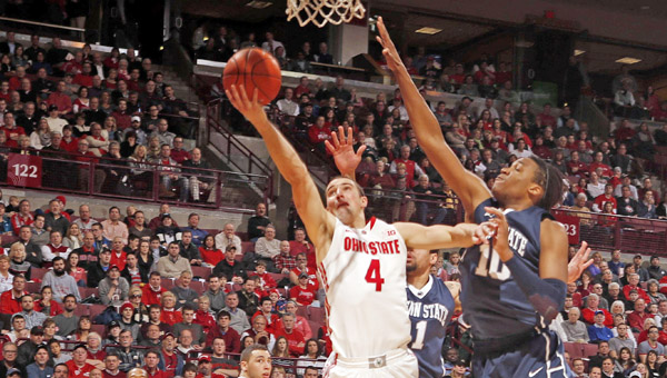 Ohio State's Aaron Craft (4) puts a shot up against Penn State's Brandon Taylor (10). Craft and the Buckeyes are trying to find answers to their inconsistent play. (MCT Direct Photos)