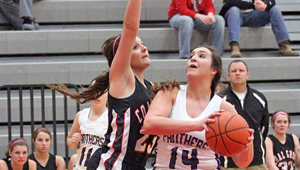 Chesapeake Lady Panthers Kaylee curry (14) drives for two of her 22 points as Coal Grove's Summer Willis defends. Chesapeake beat the Lady Hornets 49-37 Wednesday in the Division III sectional tournament. (Tim Gearhart of Tim's News & Novelties in Ironton)
