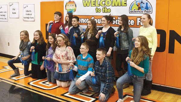 Science fair winners pose with their awards Friday at Ironton Middle School.