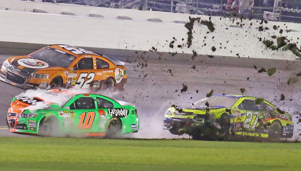 Way To GoDaddy: Danica Patrick (10) and Paul Menard (27) wreck during the Daytona 500 at Daytona International Speedway in Daytona Beach, Fla., on Sunday. (MCT Direct Photo)