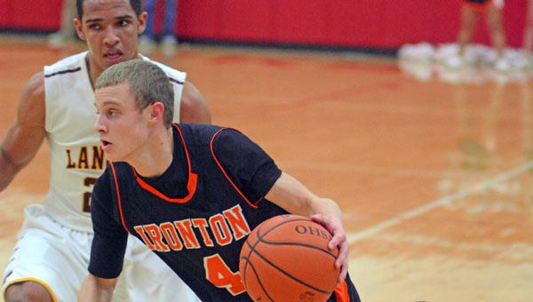 Ironton Fighting Tigers' guard Phillip Kratzenberg (4) drives toward the basket as he looks to score against Federal Hocking. Ironton beat the Lancers 60-38 in the Division III sectional tournament semifinals Wednesday. (Kent Sanborn of Southern Ohio Sports Photos)