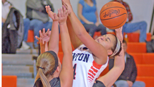 Ironton Lady Fighting Tigers' Alyssa Lewis is fouled from behind during Saturday's game against Oak Hill. Ironton just missed a major upset before losing 42-40. (Kent Sanborn of Southern Ohio Sports Photos)