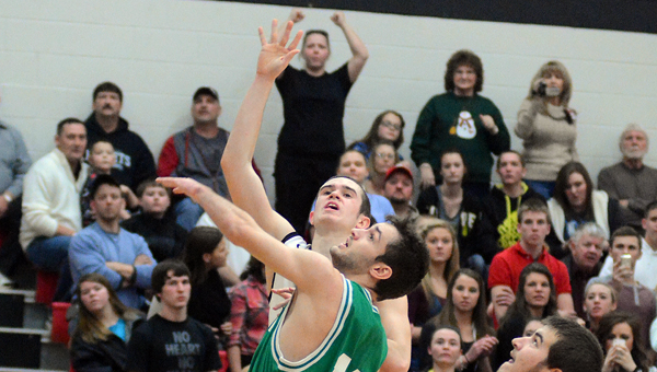 Coal Grove Hornets' senior Conor Markins scores his 1,000th career points during Tuesday's game. Fairland's Evan Maddox also reached the 1,000 career points total in the game. Coal Grove beat Fairland 76-69. (Kent Sanborn of Southern Ohio Sports Photos)