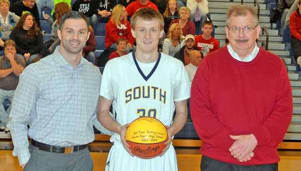 South Point Pointers' senior Brandon Barnes (center) was honored before Friday's game as the boys' new all-time leading career scorer with 1,447 points. Barnes surpassed the previous two top scoerers Shane Holsinger (left) and Kenny Hurst (right). (Kent Sanborn of Southern Ohio Sports Photos)
