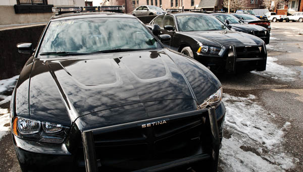 Five cruisers are seen in the parking lot area beside the Lawrence County Jail. The vehicles are in need of radios and striping.
