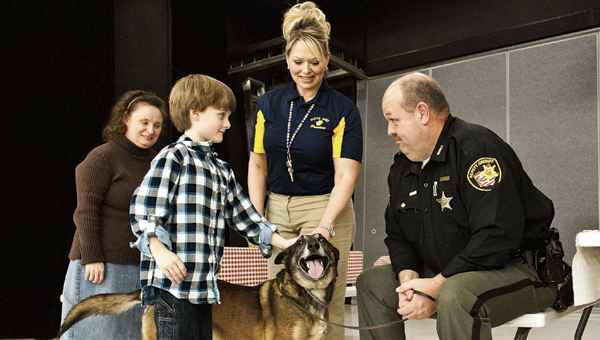THE TRIBUNE/JESSICA ST JAMES (ABOVE) Burlington Elementary student Garrett Childers visits with Deputy Steve Wilson and Hemi during a special visit on Friday.  (