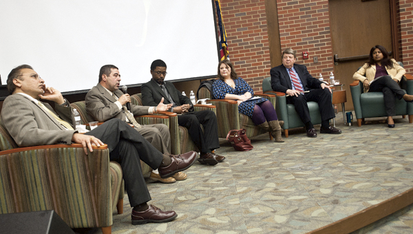 THE TRIBUNE/JESSICA ST JAMES Panelist members Dr. Jagan Valluri, Dr. Majed Khader, Rev. Sneed and Amanda White, pictured left to right, seen with moderators Dr. John Webster and Dr. Purba Das convene at Ohio University Southern for a Interfaith Dialogue: Finding Our Common Ground event. The dialogue allows communication with other people who have different traditions and faiths from their own.