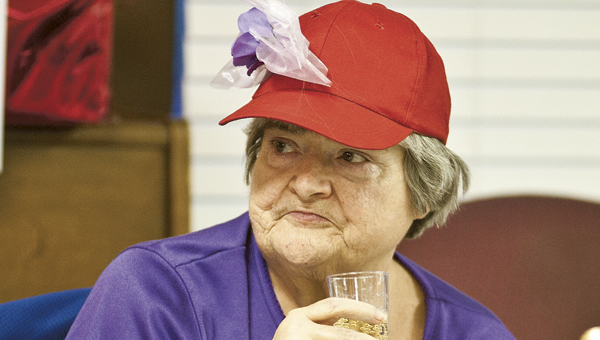 THE TRIBUNE/JESSICA ST JAMES Connie Murphy enjoys a goblet of sparkling cider during a special Red Hat Ladies and Men's Club Candlelight Dinner at Jo-Lin Health Center in Ironton
