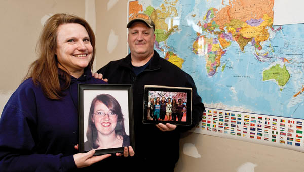 Ironton residents Laura and Ron Kettle hold photographs of  their daughter Stephanie who is currently serving on a mission trip.