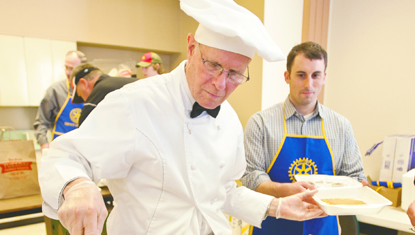 THE TRIBUNE/JESSICA ST JAMES Darwin Haynes serves up pancakes at last year's Ironton Rotary Pancake Breakfast at the AEP building downtown.