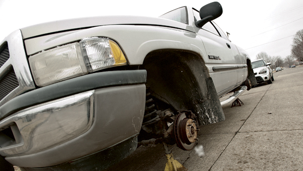 THE TRIBUNE/JESSICA ST JAMES A truck, owned by Buddy and Marci Kleinman of Ironton, needs to have two tires replaced. Vehicles up and down the 2700 blocks on 10th and 11th streets were the object of tire slashing vandalism early Monday morning.
