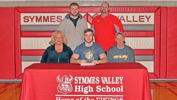 Symmes Valley Vikings' senior lineman Philip Combs signs a letter-of-intent to play for Alderson-Broaddus University. Attending the ceremony were: seated from left to right, mother Trena, Philip and father Paul Combs; standing from left to right, brother Jonathan Combs and Vikings' head football coach Rusty Webb. (Robert S. Stevens & The Gold Studio in Ironton)