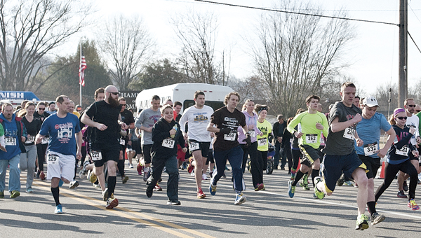 THE TRIBUNE/JESSICA ST JAMES Participants take off from the start line Saturday morning as make their way into The Point Industrial Park during the Board of DD 5k Run Walk event.