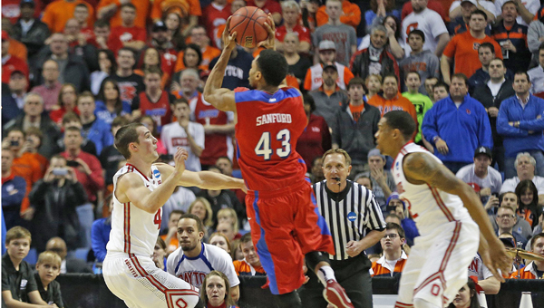 Dayton Flyers guard Vee Sanford (43) puts up the game-winning basket in the second half at the First Niagara Center in Buffalo, N.Y., on Thursday. The Dayton Flyers defeated the Ohio State Buckeyes, 60-59, during the second round of the NCAA Tournament. (MCT Direct Photo)