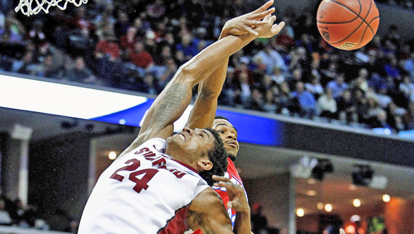Dayton Flyers' Vee Sanford, middle, and Jordan Sibert, right, grabs a rebound away from Stanford Cardinal's Josh Huestis, left, during first-half action in the NCAA Tournament's Sweet 16 game at FedExForum in Memphis, Tenn., on Thursday. Dayton won 82-72. (MCT Direct Photo)