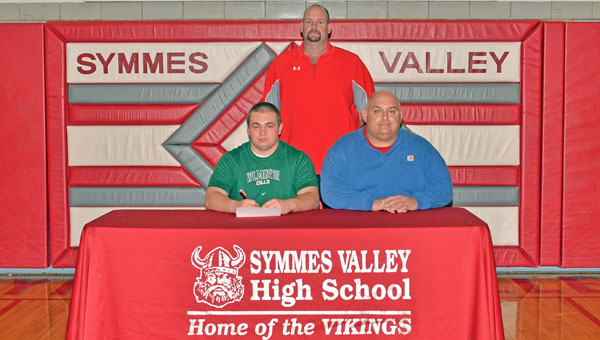Symmes Valley Vikings' senior lineman Ben Ferguson signs a letter-of-intent to play for Wilmington College. Attending the ceremony were: seated from left to right, Ben and father Matt Ferguson; standing is Vikings' head football coach Rusty Webb. (Robert S. Stevens & The Gold Studio in Ironton)