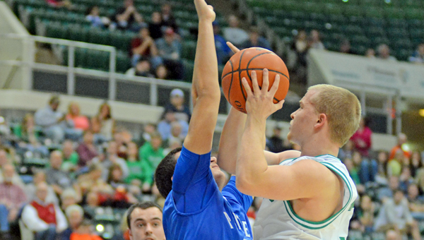 Fairland Dragons' Thayer Flynn (right) drives for a layup against a Southeastern defender during Friday's Division III district tournament game. Fairland won 58-56. (Kent Sanborn of Southern Ohio Sports Photos)