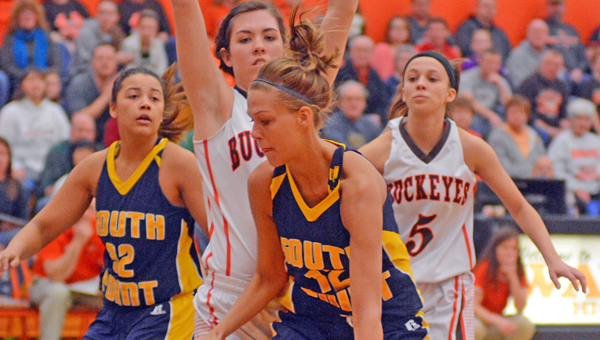 South Point Lady Pointers' senior center Brett Justice tries to drive past a Nelsonville-York defender during Saturday's Div. III district title game. The Lady Pointers lost 43-26. (Kent Sanborn of Southern Ohio Sports Photos)