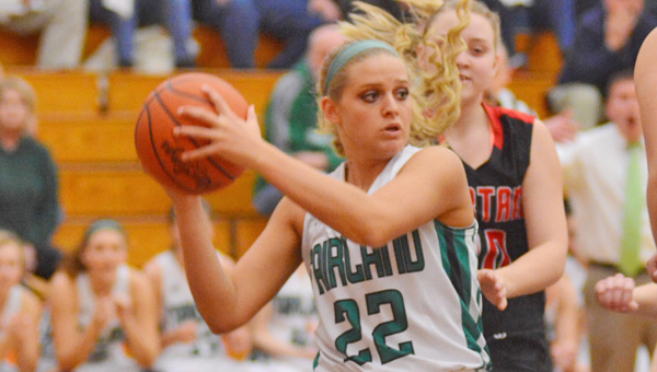 Fairland Lady Dragons' Kelsey Riley (22) looks to make an outlet pass after grabbing a rebound during Saturday's 62-37 Div. III district championship win over Albany Alexander. (Kent Sanborn of Southern Ohio Sports Photos)