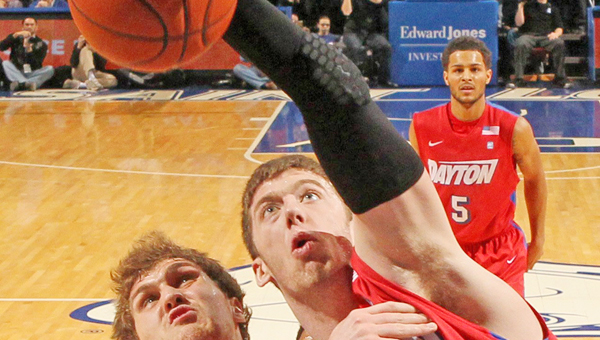 Dayton's Matt Kavanaugh (35) competes for a rebound against Saint Louis' Rob Loe during a Flyers' win this season. Dayton plays Ohio State Thursday in the NCAA tournament. (MCT Direct Photo)