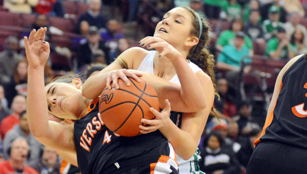 Fairland Lady Dragons' Mackenzie Riley (right) goes over the shoulder of Versailles' Emily Harman as they battle for a rebound during Friday's Division III state basketball semifinal game at the Ohio State University Schottenstein Center. (Kent Sanborn of Southern Ohio Sports Photos)