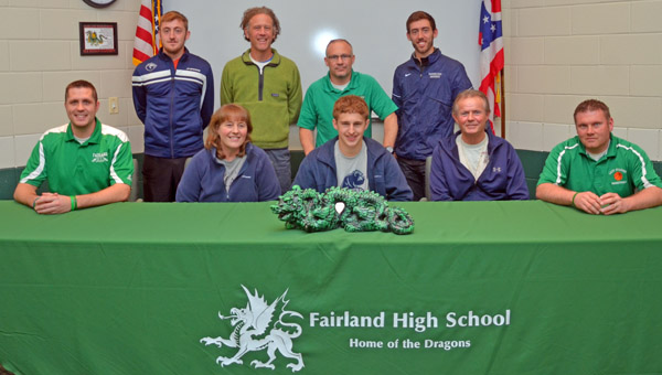 Fairland Dragons' senior cross country and track runner Chad McComas signed a letter-of-intent Monday with Shawnee State University. Attending the signing were: seated from left to right, Fairland assistant coach Adam Alt, mother Deanna Thompson, Chad, father Randy Thompson and Fairland assistant coach Jon Buchanan; standing from left to right, SSU runner Ryan Stewart, SSU head coach Eric Putnam, Fairland head coach Chuck Wentz and SSU runner Joe Stewart. (Kent Sanborn of Southern Ohio Sports Photos)