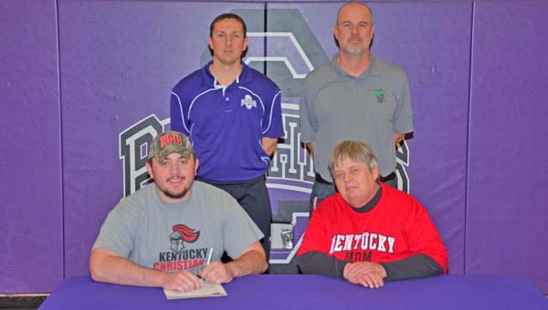 Chesapeake Panthers' senior lineman Mark McMillian signs a letter-of-intent to play at Kentucky Christian University. Attending the ceremony are: seated from left to right, McMillian and mother Emily Gano; standing from left to right, Panthers' head coach Andy Clark and assistant coach Chris Ball. (Kent Sanborn of Southern Ohio Sports Photos)