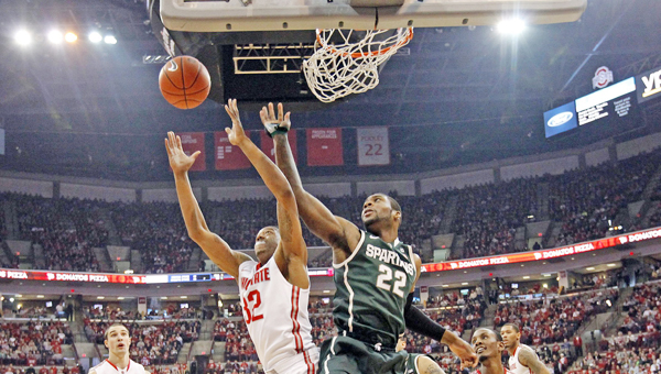 Ohio State Buckeyes guard Lenzelle Smith Jr. (32) and Michigan State Spartans guard/forward Branden Dawson (22) reach for a rebound during Sunday's game at Ohio State. The Buckeyes beat Michigan State 69-67 and open Big Ten Tournament play Thursday afternoon as the No. 5 seed. Michigan State will be the No. 2 seed. (MCT Direct Photo)