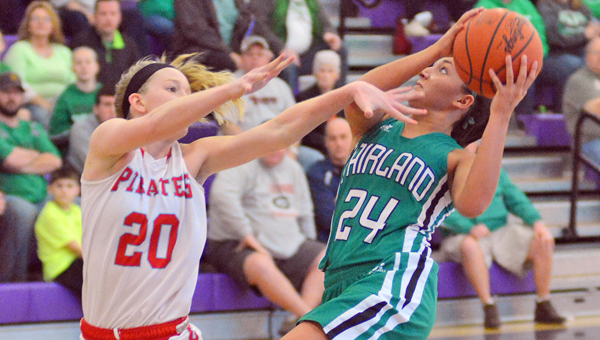 Fairland Lady Dragons' Taylor Perry (24) drives for a layup during Saturday's Division III regional finals. Fairland won 52-46 and plays Versailles at 3 p.m. Friday in the state semifinals at the Jerome Schottenstein Center on the campus of Ohio State University. (Kent Sanborn of Southern Ohio Sports Photos)