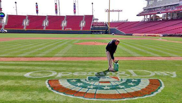 Ground crew members prepare the field at Great American Ball Park for Opening Day on Monday when the Cincinnati Reds host the St. Louis Cardinals. First pitch is scheduled for 4:10 p.m. (Photo Courtesy of The Cincinnati Reds)