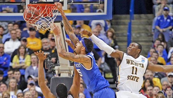 Kentucky Wildcats forward Willie Cauley-Stein (15) goes baseline for a dunk over Wichita State Shockers forward Darius Carter (12) during the third round of the NCAA Tournament in St. Louis on Sunday. The Kentucky Wildcats defeated the Wichita State Shockers, 78-76. (MCT Direct)