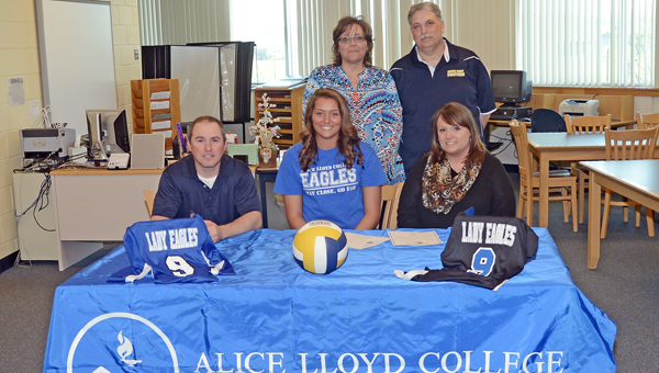 South Point Lady Pointers' senior Lakin Adams signed a letter-of-intent to play volleyball at Alice Lloyd College. Attending the ceremony were: seated from left to right, South Point head coach Allen Perry, Lakin, and Alice Lloyd assistant coach Jolene Watts; standing from left to right, parents Angie and Dave Adams. (Kent Sanborn of Southern Ohio Sports Photos)