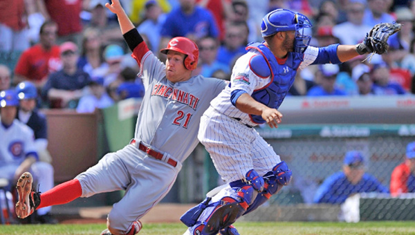 Cincinnati's Todd Frazier slides safely across home plate during the fifth inning of Sunday's game. The Reds beat the Chicago Cubs 8-2. (Photo Courtesy of The Cincinnati Reds)