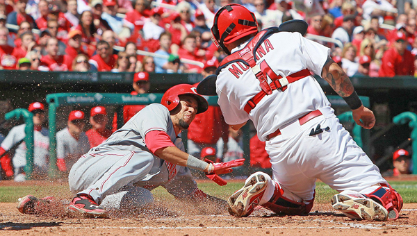Cincinnati Reds' Billy Hamilton scores past St. Louis Cardinals catcher Yadier Molina on a sacrifice fly in fifth-inning action on Wednesday at Busch Stadium in St. Louis. (MCT Direct)