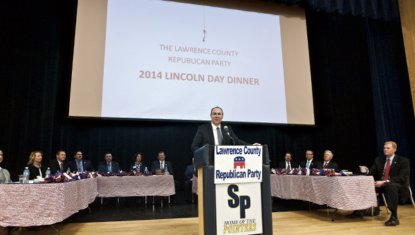 THE TRIBUNE/JESSICA ST JAMES Joe Freeman and eventgoers sitting around him react to speakers on stage during the annual Lincoln Day Dinner Tuesday.